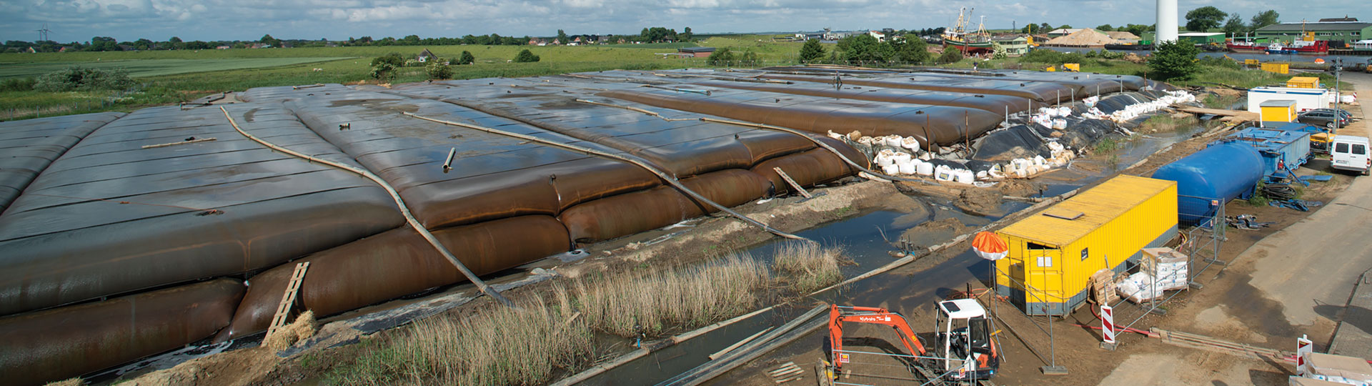 Storage of dewatered silt in geotextile containers.